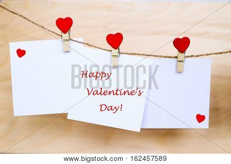 Happy Valentine's Day On Stickers Hanging On Heart Shape Pins