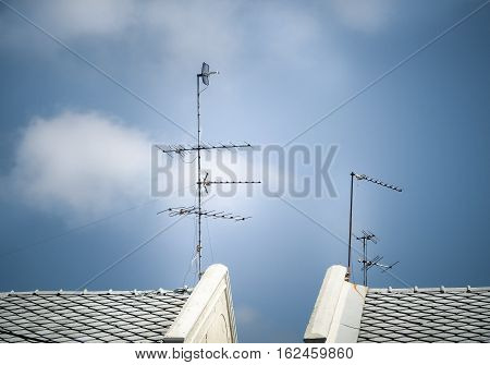 Old antenna for television with blue sky background, Silhouetted image