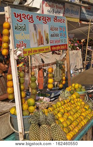 AHMADABAD, INDIA - OCTOBER 31, 2007: Man selling fruit juice from a cart at a street market in Ahmadabad, Gujarat, India