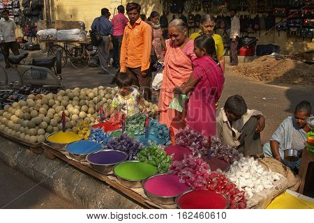 AHMADABAD, INDIA - OCTOBER 30, 2007: Street market with women selling colorful paint powder for the Hindu festival of Holi in Ahmadabad, Gujarat, India