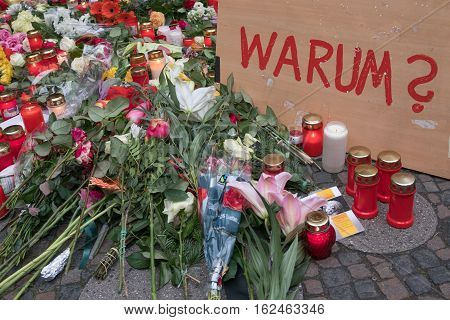 Berlin Germany - december 20, 2016: Candles flowers and a sign with the german word