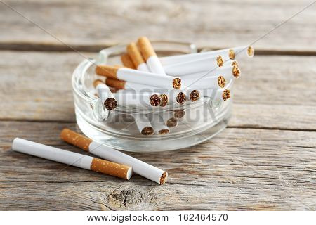 Tobacco Cigarettes On A Grey Wooden Table