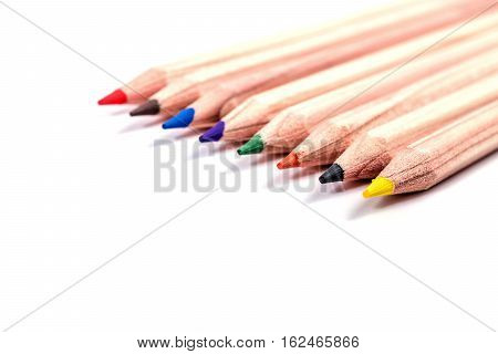 Back to school. Multicolored pencils isolated on white background. Wooden colorful crayons