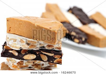 some pieces of different kind o turron, typical Christmas sweet of Spain poster
