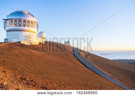 Telescopes on top of Mauna Kea Mountain at sunset, Big Island, Hawaii, Usa