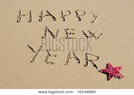 sentence happy new year written in the sand