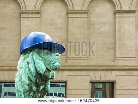 Chicago IL USA october 27 2016: Chicago Art Institute entrance lion sculpture with Chicago Cubs hat