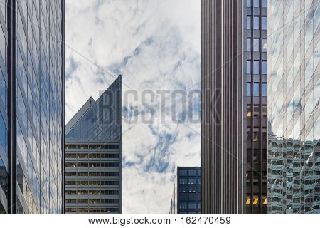 Chicago downtown skyscrapers looking up a cloudy sky