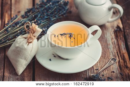 Bunch Of Lavender Flowers, Healthy Tea In Cup, Teapot And Sachets Filled With Dried Lavender. Retro