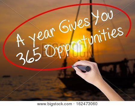 Woman Hand Writing A Year Gives You 365 Opportunities With A Marker Over Transparent Board