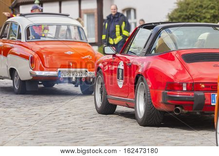 ALTENTREPTOW / MECKLENBURG - WEST POMERANIA / GERMANY - MAY 2015: Porsche 911 drives along a street on an oldtimer festival