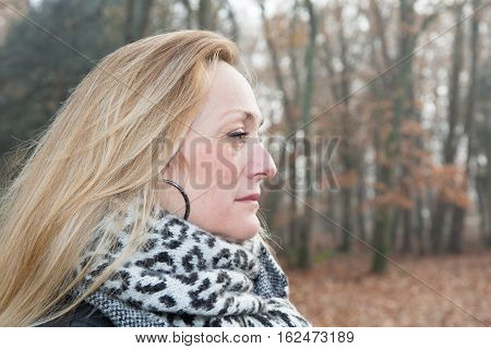Blond Mature Woman Looking In Forest Park
