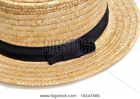 closeup of a straw hat isolated on a white background