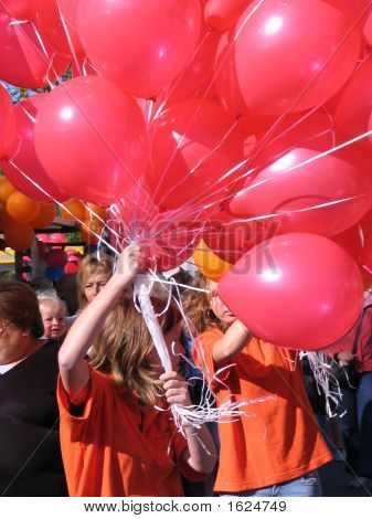 A Bunch Of Red Balloons