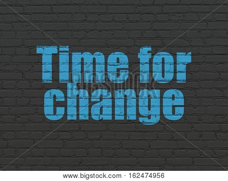 Time concept: Painted blue text Time for Change on Black Brick wall background