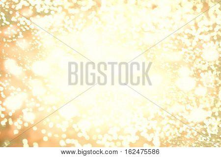 Abstract golden bokeh background. Christmas lights. Festive defocused boke