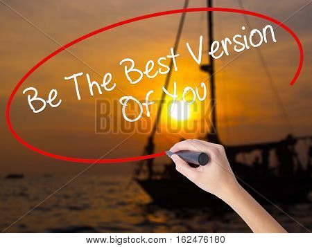 Woman Hand Writing Be The Best Version Of You With A Marker Over Transparent Board