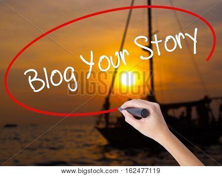 Woman Hand Writing Blog Your Story  With A Marker Over Transparent Board