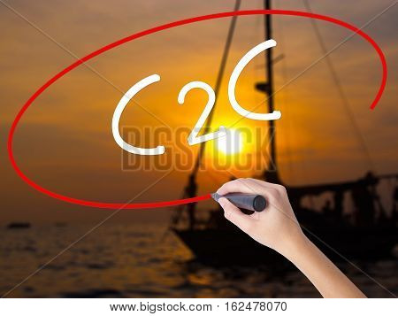 Woman Hand Writing C2C With A Marker Over Transparent Board