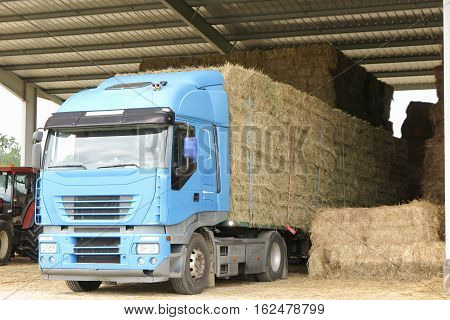 a farm truck in rural country for straw transportation