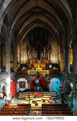MULHOUSE FRANCE - DEC 12 2015: Temple Saint-Etienne Church Cathedral (Protestant St. Stephen's Church) being prepared for Christmas with Christmas Tree being decorated and lights being arranged - elevated view