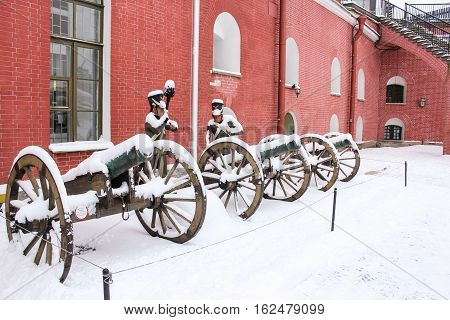 St. Petersburg, Russia - 2 December, Exposition of old cannons with grenadiers, 2 December, 2016. Land and building the Peter-Paul fortress.