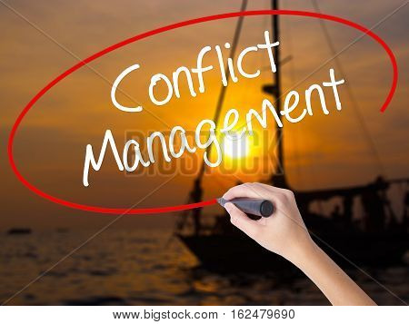 Woman Hand Writing Conflict Management With A Marker Over Transparent Board.