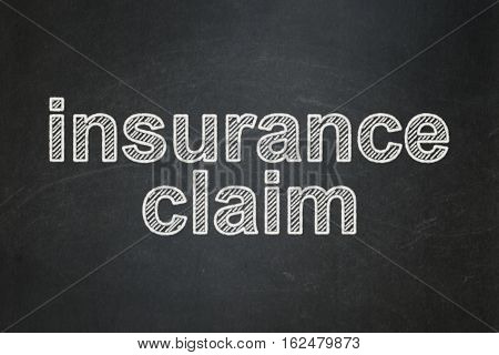 Insurance concept: text Insurance Claim on Black chalkboard background