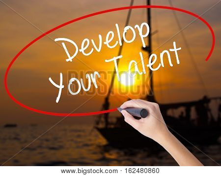Woman Hand Writing Develop Your Talent With A Marker Over Transparent Board.
