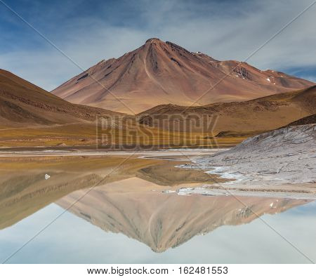 Volcano reflection at Pierdras Rojas Atacama desert Chile