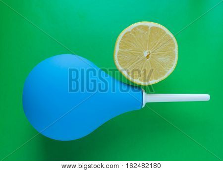 Blue medical enema and fresh lemon - dieting and medical concept