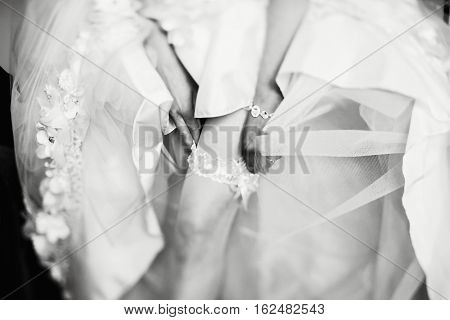 Graceful leg with a garter enveloped in tulle