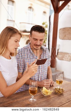 Blond Girl Showing Guy Something On Cellphone