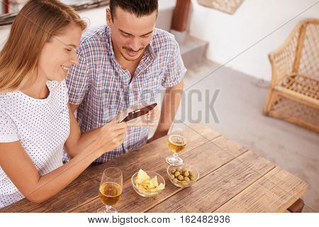 Young Couple With Cellphone From Above
