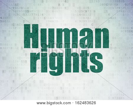 Political concept: Painted green word Human Rights on Digital Data Paper background