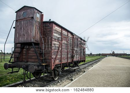 Historic Train on rails at concentration camp Auschwitz Birkenau KZ Poland