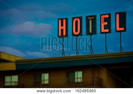 Cheap hotel with a sign where the