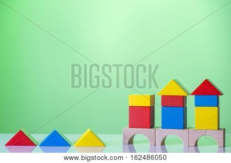 Logical test. Abstract construction from wooden blocks with copy space. The concept of logical thinking geometric shapes.