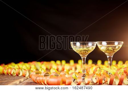 Two Glasses Of Wine And Papper Ribbons