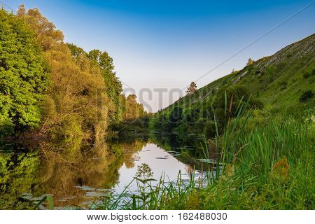 Summer landscape Root River. The river valley at the foot of the chalk hills archaeological monument - Krapivinskaya settlement Belgorod region Russia.