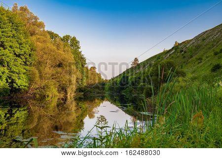 Summer landscape Root River. The river valley at the foot of the chalk hills archaeological monument - Krapivinskaya settlement Belgorod region Russia.