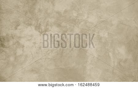 Abstract Grungy Decorative Rough Old Stucco Wall Vintage style Background. Handmade Sepia Beige Paper Texture With Copy Space