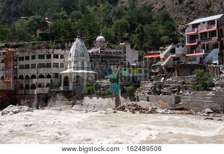 View of the rapid river Parvati near Sikhs temple and a Gurudwara, Manikaran, Himachal Pradesh, Northern India.