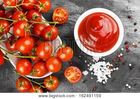 Tomato Sauce In White Bowl, Spice And Cherry Tomatoes On A Dark Background. Tomato Sauce In White Bo