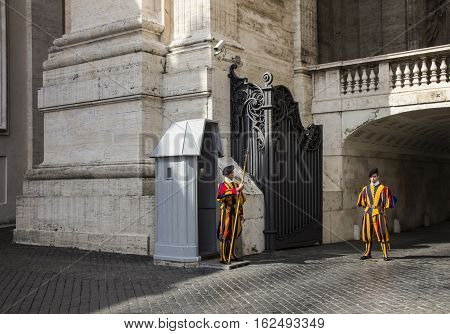 Swiss Guards and official in arch entrance located in St. Peter's Square in Rome,Italy