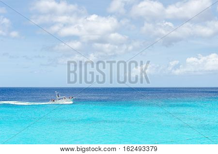Scuba Divers Passing By The Beautiful Grand Knip Beach