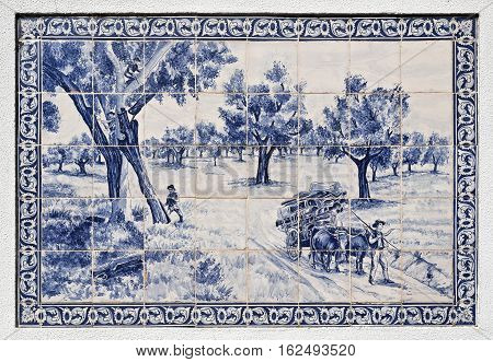 Tiles panel depicting the traditional harvesting of cork from the cork oak trees on a wall in Azeitao Portugal by unknown author