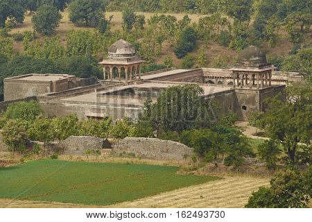 MANDU, INDIA - NOVEMBER 17, 2008: Historic Baz Bahadur's palace set in fields inside the hilltop fort of Mandu in Madyha Pradesh, India. Built in stages from 15th century onwards.