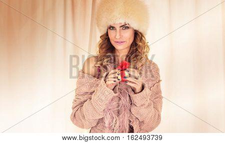 Woman Unpacking Gift.
