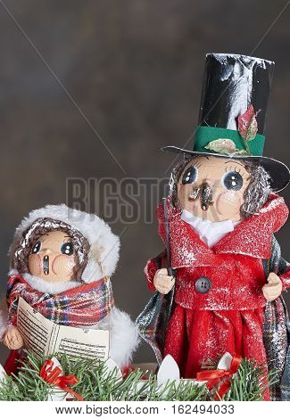 Christmas Holiday ornaments depicting 19th. century carol singers in the snow